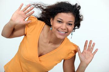 happy woman raising hands