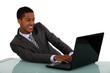 Black businessman sat with laptop