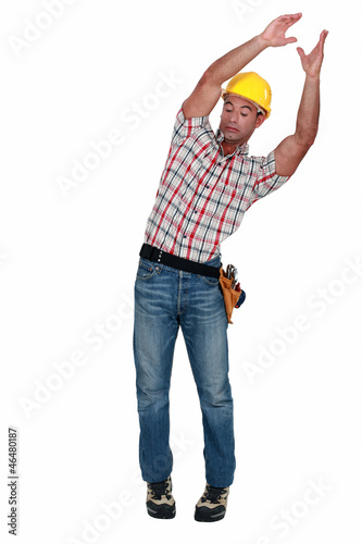 craftsman carrying something and trying to keep balance