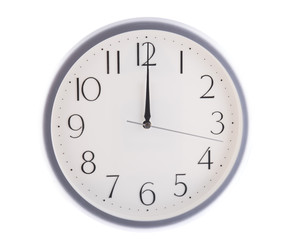 isolated white clock at 12