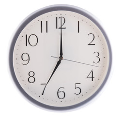 isolated white clock at  seven