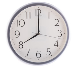 isolated white clock at eight