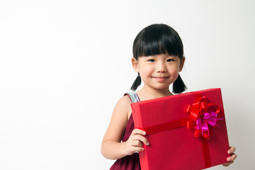 Asian child with red gift box