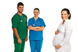 Happy pregnant woman and doctors