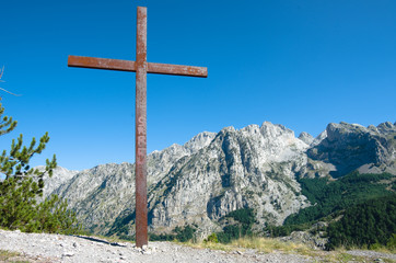 Rusty Crucifix And Albanian Mountains