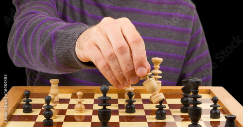 Chessboard with man thinking about chess strategy, isolated