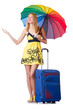 Woman going to summer vacation with suitcase