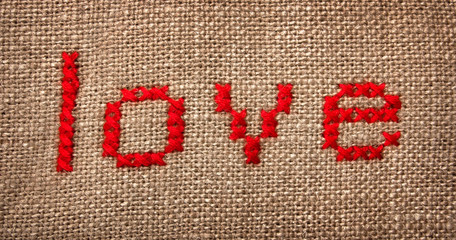Embroidered word 'love'