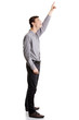 Young happy businessman pointing up with his finger