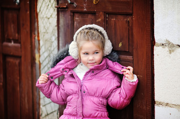 Portrait of an adorable toddler girl wearing fashion knitted clo
