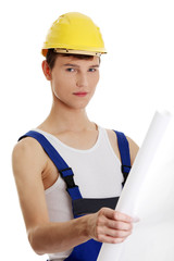 Young builder man holding plans