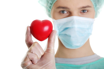 Surgeon doctor holding heart shape toy