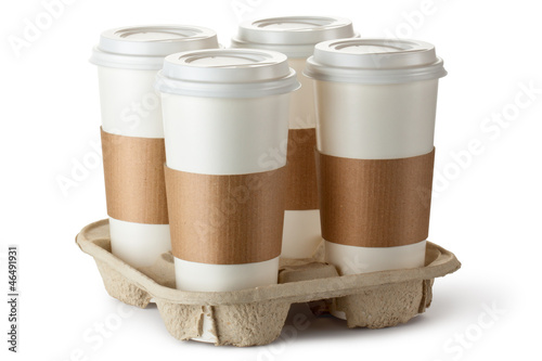 Four take-out coffee in holder