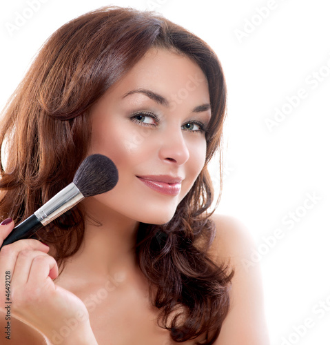 Beautiful Young Woman Applying Makeup