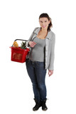 Happy woman with shopping basket