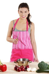 Young woman cooking healthy food in pot