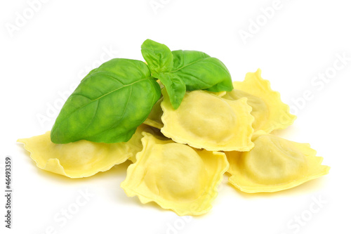 Fresh ravioli with green basil on white