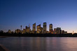 Skyline View of Sydney at dawn seen from the botanical gardens