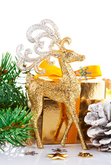 gold deer with branch firtree and gift isolated on white