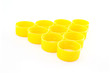 Yellow plastic bottle caps isolated on white background