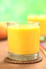 Fresh homemade mango juice in glass