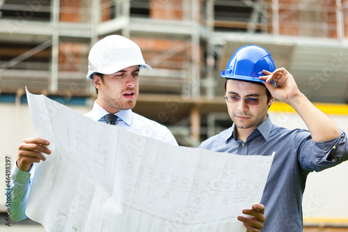 Couple of engineers at building site