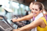 Running on treadmill in gym or fitness club