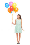 Woman holding a bunch of balloons