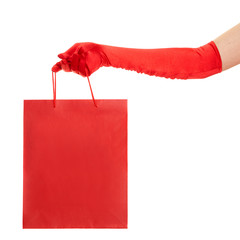 Hand in red gloves holding bag isolated over white background