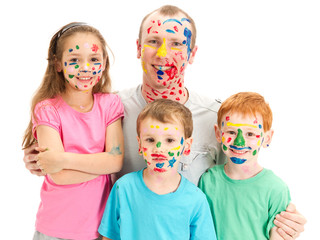 Family of kids and dad with messy painted faces