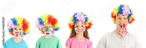 Painted faces and clown wigs on family kids