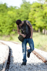 Man walking on railroad