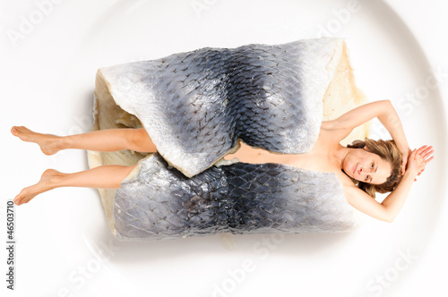 Woman wrapped in fish