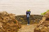 Birdwatcher on a coastal viewpoint poster