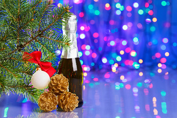Christmas tree decorations with spruce and champagne on bokeh ba