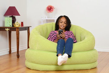 Child watching movie on cell phone