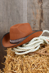 Closeup cowboy hat and ropes