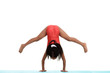 Young child trying to do handstand