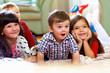 Leinwanddruck Bild - group of happy kids watching tv at home