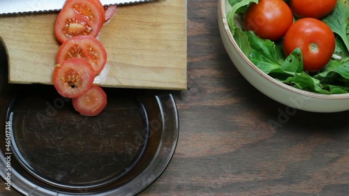 serving sliced tomatoes in a plate