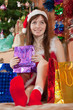 Girl sits with christmas gifts