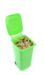 A green recycling rubbish wheelie bin filled  with money