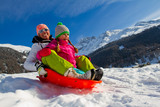 Winter fun, snow, sledding at winter time