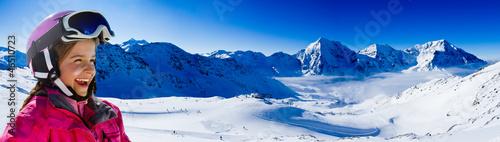 Ski, snow, sun and winter fun - happy young skier