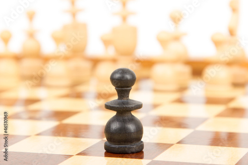 Black chess pawn isolated