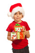 Smiling boy holding Xmas gifts