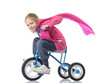 The little girl on a children's bicycle