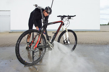 man washing the bike