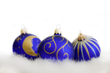 Christmas blue baubles on white background closeup