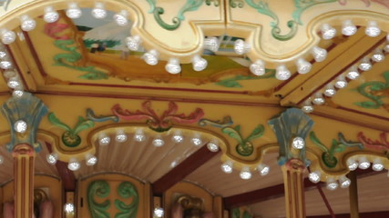 Amusement park details. Glowing lights and various ornaments.